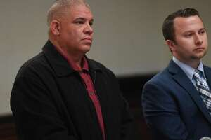 Norwalk police office Hector Delgado, left, 46, of Stratford, appears with his lawyer Noah Kores in Superior Court in Bridgeport, Conn. on Tuesday, November 12, 2019.