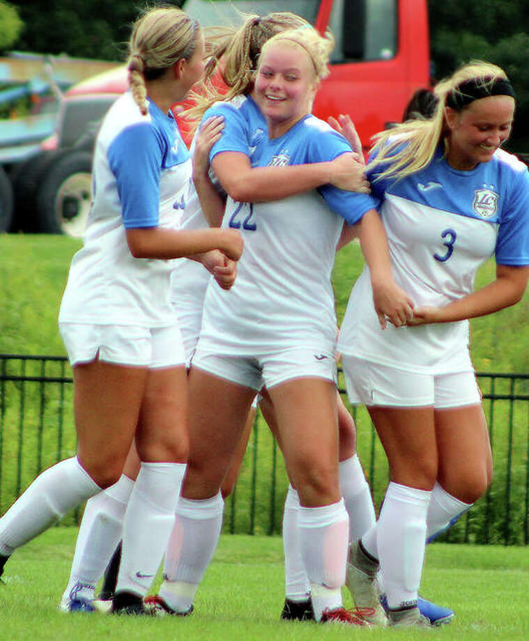 Jocelyn Wagner of LCCC (22) celebrates with teammates earlier this season during a win over Iowa Lakes CC. Wagner, a sophomore defender from Edwardsville, suffered a torn ACL in last week's Central District championship game and won't play in next week's NJCAA National Tournament in Melbourne, Fla. Photo: Pete Hayes | The Telegraph