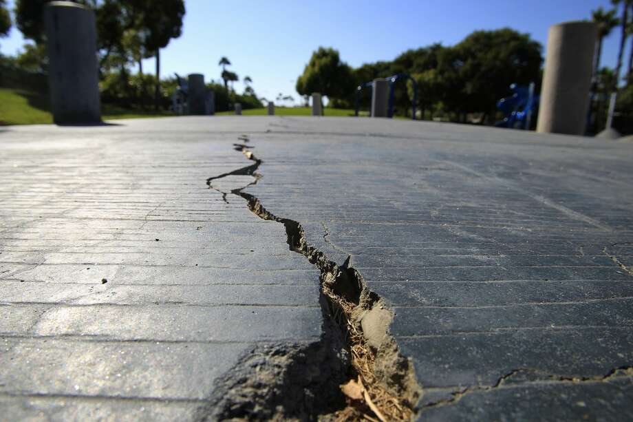 A long crack splits the sidewalk at the Discovery Well Park in Huntington Beach, Calif., located on top of the Newport-Inglewood fault. Officials have released new draft maps showing the locations of earthquake faults in Santa Monica, Beverly Hills and Los Angeles' Westside, raising the prospect of development restrictions in areas directly above the fissures. (Allen J. Schaben/Los Angeles Times/TNS) Photo: Allen J. Schaben/TNS