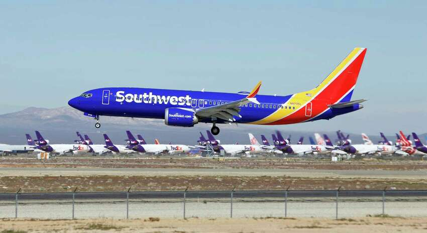 FILE - In this March 23, 2019, file photo, a Southwest Airlines Boeing 737 Max aircraft lands at the Southern California Logistics Airport in the high desert town of Victorville, Calif. The union president of Southwest Airlines pilots worries that Boeing may be rushing the 737 Max back into service, and he says Southwest should consider buying planes from another company. The union president, Jon Weaks, adds that Boeing has exhibited arrogance and greed that will haunt the company forever. (AP Photo/Matt Hartman, File)