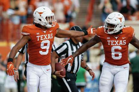 UT receivers Collin Johnson (9) and Devin Duvernay were part of the same recruiting class under former coach Charlie Strong.