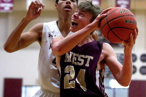 Magnolia West guard J.P. Ellwenger (24) will be one of the top returning players for the Mustangs this season.