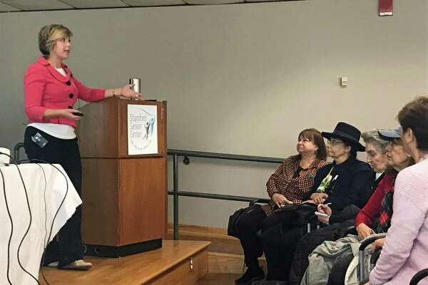 Claire Côté, of the State Unit on Aging, lead a conversation on Wednesday morning at the Stamford Senior Center.