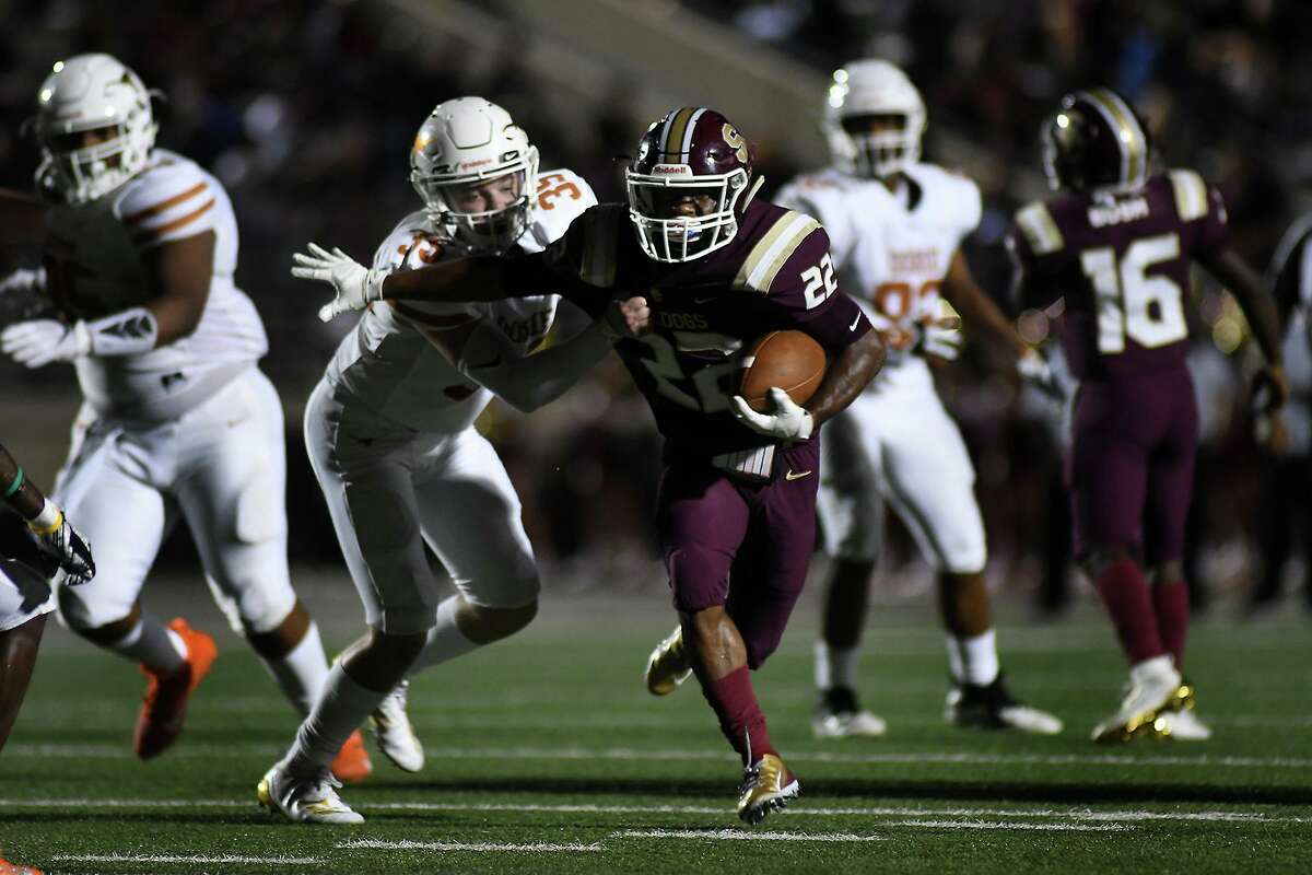 Summer Creek sophomore running back Torrie Curry (22) tries to break away from Dobie junior linebacker Kyle McDonald (35) on a second quarter running play in their district matchup at Turner Stadium in Humble on Sept. 20, 2019.