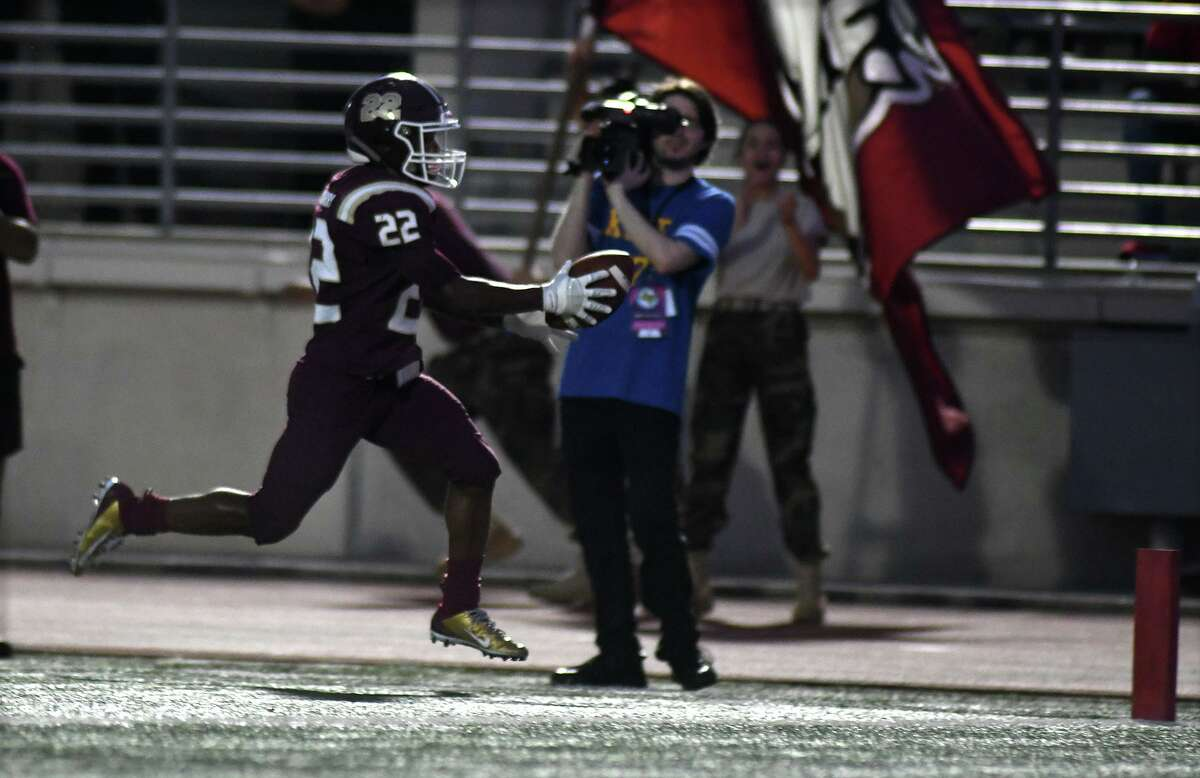 Summer Creek sophomore running back Torrie Curry (22) skips into the end zone on a first quarter running play against Dobie in their district matchup at Turner Stadium in Humble on Sept. 20, 2019.