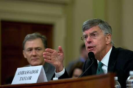 Top U.S. diplomat in Ukraine William Taylor testifies before the House Intelligence Committee on Capitol Hill in Washington, Wednesday, Nov. 13, 2019, during the first public impeachment hearing of President Donald Trump's efforts to tie U.S. aid for Ukraine to investigations of his political opponents.