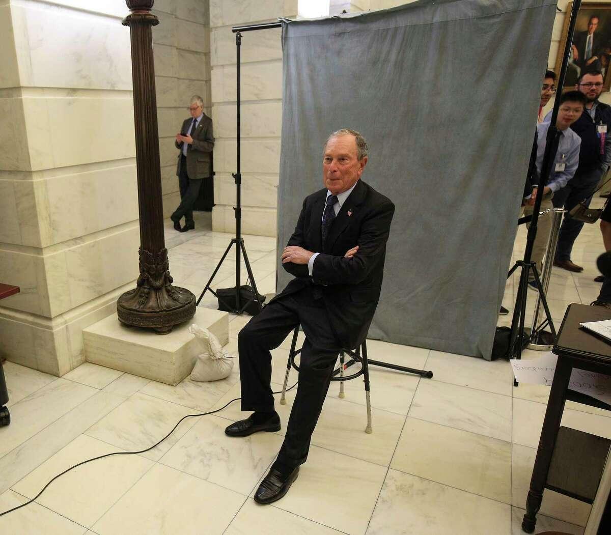 Former New York City Mayor Michael Bloomberg poses for his candidate photo as he files paperwork, Tuesday, Nov. 12, 2019, at the state Capitol in Little Rock, Ark., to appear on the ballot in Arkansas' March 3 presidential primary. Bloomberg hasn't formally announced a bid for the Democratic presidential nomination, but his trip to Arkansas is the latest indication that he is leaning toward a run. (Staton Breidenthal/The Arkansas Democrat-Gazette via AP)