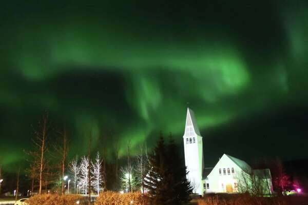 Sandy Farah of Cohoes shares this view from the backyard of their hotel in Selfoss, Iceland on Oct. 24. a€œWe were treated to this magnificent sight three nights in a row! Something very rare.a€