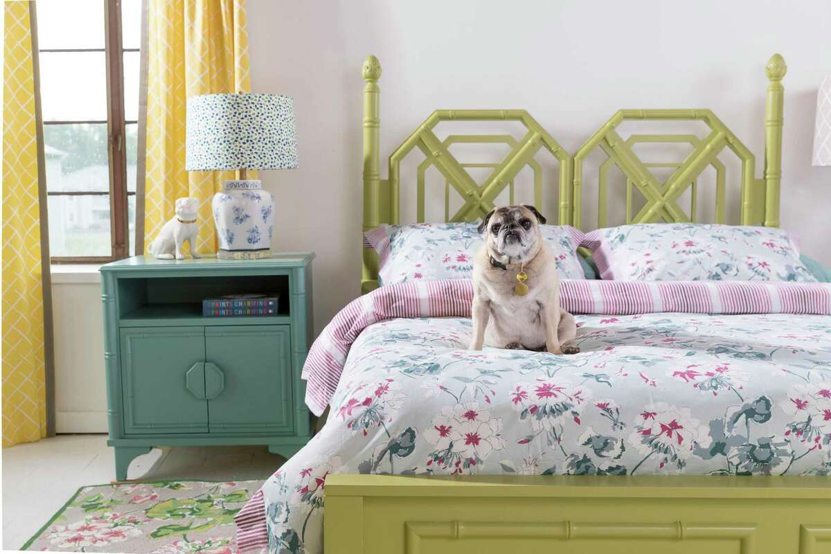 Faux bamboo trim brings chinoiserie to this bedroom furniture designed by Madcap Cottage.