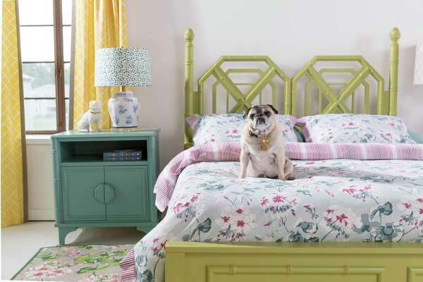 Faux bamboo trim brings chinoiserie to this bedroom furniture designed for Newport Cottages.