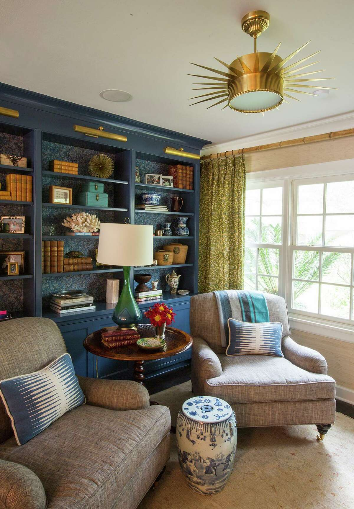 A ceramic garden stool with Asian motifs adds a touch of chinoiserie to this room designed by Lindsey Herod Interiors.