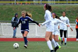 RHAM's Bailey Ayer, left, plays the fall during a game against Brookfield on Thursday.