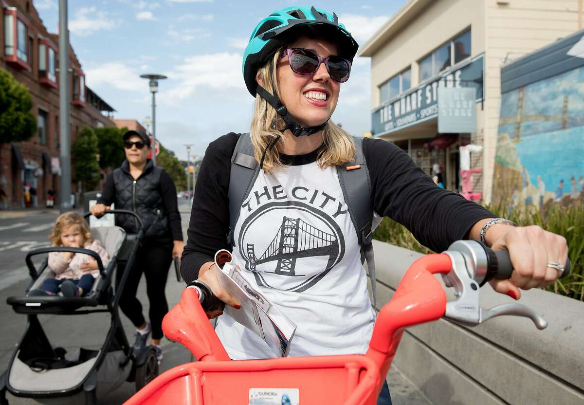 San Francisco Chronicle reporter Heather Knight gets on a JUMP bike along Jefferson Street in Fisherman's Wharf in San Francisco, Calif. Wednesday, September 4, 2019 as she and fellow reporter Peter Hartlaub attempt to traverse San Francisco�s 49-mile Scenic Drive without using a car.