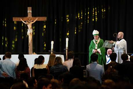 Archbishop of Galveston-Houston Daniel DiNardo acknowledges the Archdiocese Youth Council during the Archdiocesan Youth Conference Sunday Mass on Sunday, July 28, 2019, in Houston.
