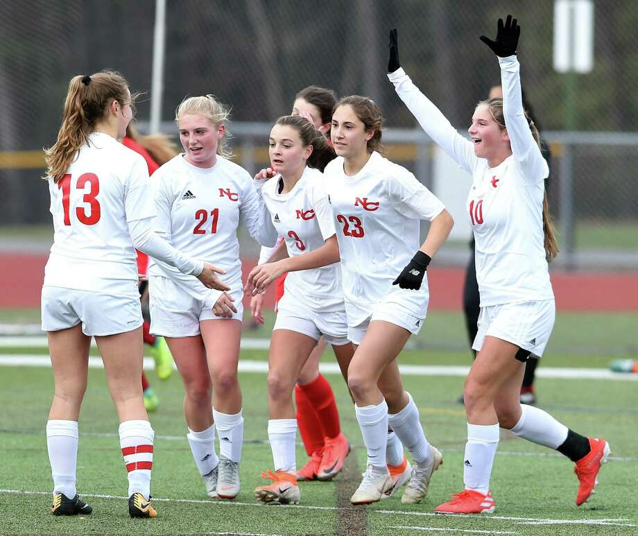 New Canaan celebrates after Dillyn Patten (center) scored against Cheshire on Thursday. Photo: Arnold Gold / Hearst Connecticut Media / New Haven Register