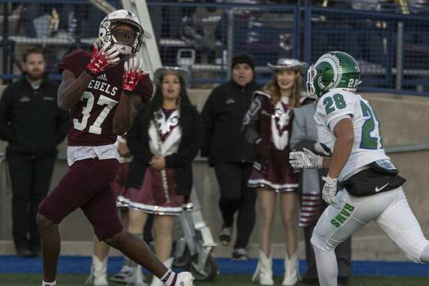 Lee High's Loic Fouonji catches a pass down the sideline and makes it into the endzone for a score after beating Montwood's Khalid Andha 11/14/19 in the Class 6A bi-district playoff game at Grande Communications Stadium. Tim Fischer/Reporter-Telegram