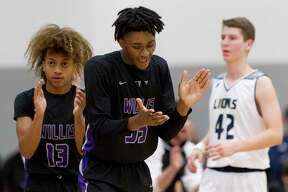 Willis point guard D'Shawn Woods (13) and forward Ja'len Moore (35) react after a Lake Creek turnover during the second quarter of a District 20-5A high school basketball game, Tuesday, Jan 29, 2019, in Montgomery.