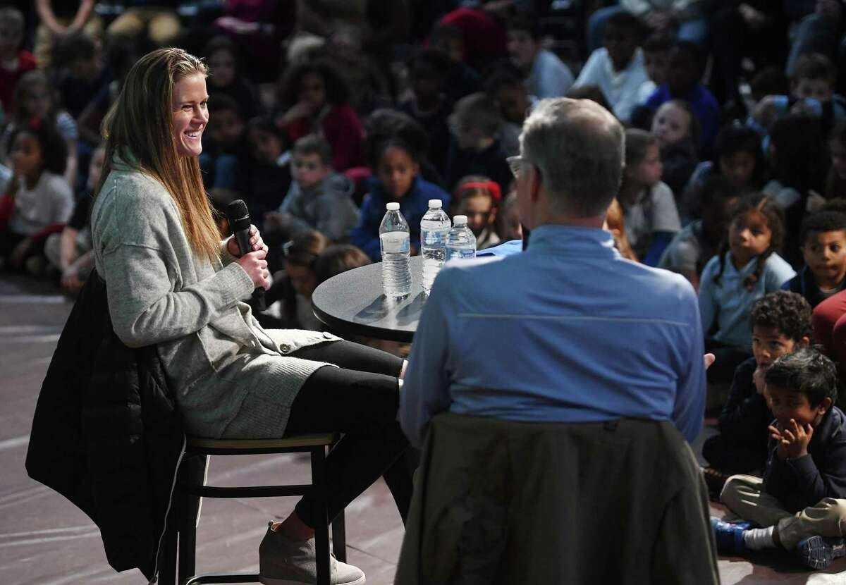 Starting goalkeeper for the United States Women's World Cup Soccer Team Alyssa Naeher, left, is interviewed by sports interviewer Dan Patrick during a visit to her alma mater, Christian Heritage School, in Trumbull, Conn. on Thursday, November 14, 2019.