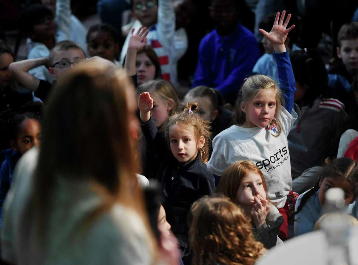 Students raise their hands with questions for United States Women's World Cup Soccer Team goalkeeper Alyssa Naeher during her visit to her alma mater, Christian Heritage School, in Trumbull, Conn. on Thursday, November 14, 2019.