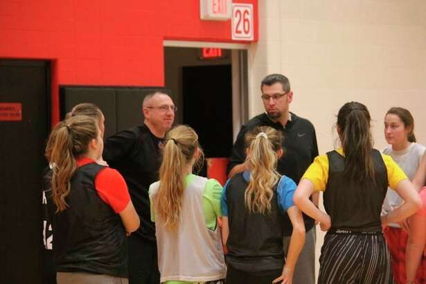 Reed City coachTim Beilfuss (right) talks with his playersafter a Wednesday practice. (Pioneer photo/John Raffel)