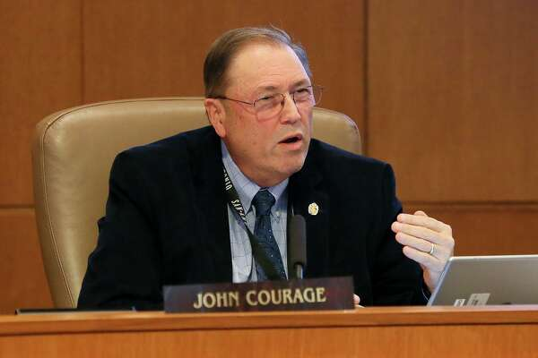 "District 9 Councilman John Courage, shown in City Hall chambers during a Nov. 14 meeting, says that although Jim Plummer has provided plenty of useful expertise, ""I think we owe it to ourselves as an organization to know that whoever is giving us the best advice is doing it under the auspices of our organization without any outside influence."""