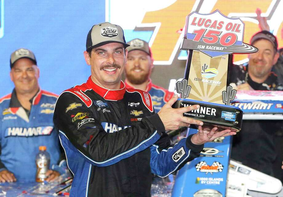 PHOENIX, ARIZONA - NOVEMBER 08: Stewart Friesen, driver of the #52 Halmar International Chevrolet, poses with the trophy after winning  the NASCAR Gander Outdoors Truck Series Lucas Oil 150 at ISM Raceway in Phoenix on November 08, 2019 in Phoenix, Arizona. (Photo by Jonathan Ferrey/Getty Images) Photo: Jonathan Ferrey / 2019 Getty Images