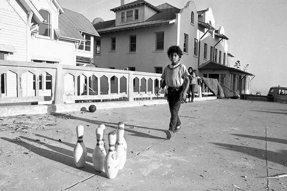 November 1969: Photo of the Native American occupation of Alcatraz. A boy, one of several children on the island, creates an outdoor bowling alley during the first few days of the occupation.