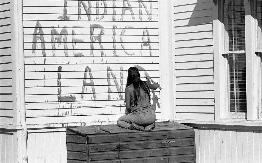 November 1969: Photo of the Native American occupation of Alcatraz. Activists paint a sign on the island during the first few days of the occupation. Photo: Vincent Maggiora / The Chronicle