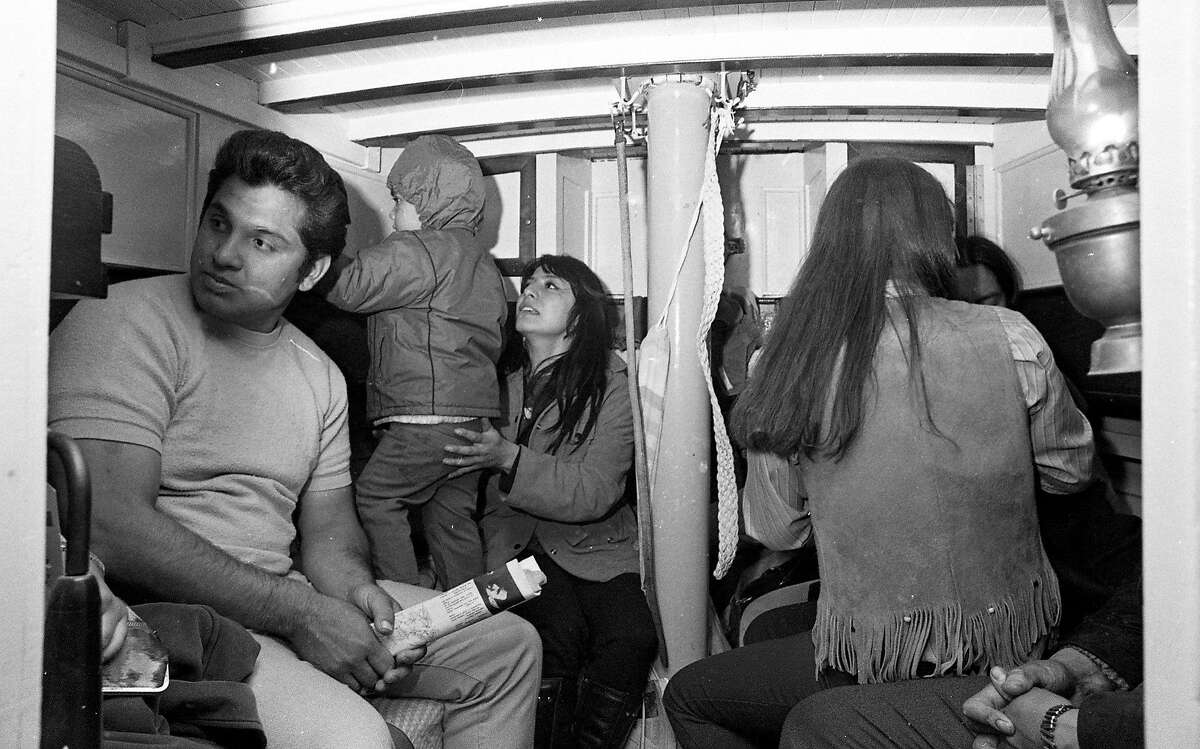 Nov. 20, 1969: Photo of the Native American occupation of Alcatraz. Richard Oakes, LaNada Means and others on the early morning boat ride from Sausalito to Alcatraz, before the group started their occupation.