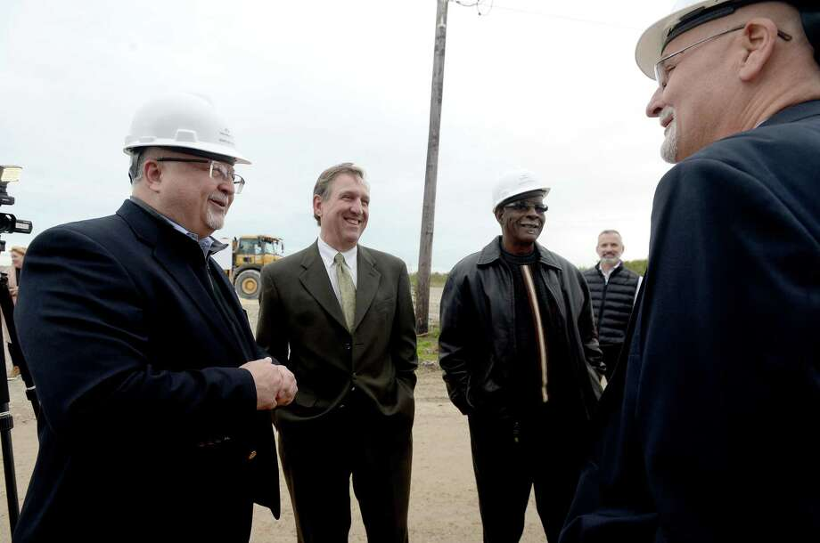 From left, Marvin Ivey, Judge Jeff Brannick, Harold Doucet and Jerry Cochran talk after they and other representatives from Port Arthur LNG, TxDOT, Jefferson County, the City of Port Arthur and Sabine Pass ISD gathered Thursday for a groundbreaking ceremony at the site where U.S. Highway 87 will be relocated. The project will extend the highway between the Intercoastal Waterway and Keith Lake Pass into Sabine Pass, where the Port Arthur LNG export project will be located. Photo taken Thursday, November 14, 2019 Kim Brent/The Enterprise Photo: Kim Brent / The Enterprise / BEN