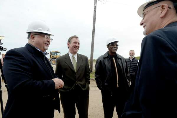 From left, Marvin Ivey, Judge Jeff Brannick, Harold Doucet and Jerry Cochran talk after they and other representatives from Port Arthur LNG, TxDOT, Jefferson County, the City of Port Arthur and Sabine Pass ISD gathered Thursday for a groundbreaking ceremony at the site where U.S. Highway 87 will be relocated. The project will extend the highway between the Intercoastal Waterway and Keith Lake Pass into Sabine Pass, where the Port Arthur LNG export project will be located. Photo taken Thursday, November 14, 2019 Kim Brent/The Enterprise