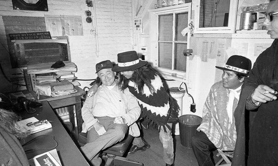 Nov. 20, 1969: Photo of the Native American occupation of Alcatraz. Activist John Trudell embraces a caretaker after landing on the island. Photo: Vincent Maggiora / The Chronicle
