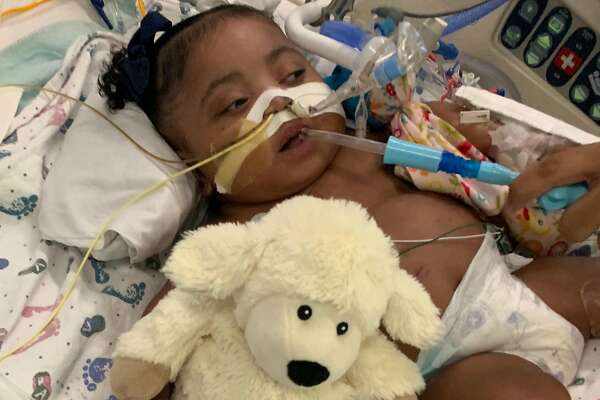 """This undated photo provided by Texas Right to Life shows Tinslee Lewis. After a hospital's plans to remove the 9-month-old girl from a ventilator against her family's wishes were halted, a spotlight is once again on the Texas law that gives families who disagree with doctors 10 days to find a new facility before life-sustaining treatment is withdrawn. Doctors at Cook Children's Medical Center in Fort Worth planned to stop treatment Sunday, Nov. 10, 2019, for Tinslee Lewis after invoking the state's so-called """"10-day rule,"""" but a judge granted her family a temporary restraining order that gives them until Nov. 22 to find a place that will take her, said Texas Right to Life spokeswoman Kimberlyn Schwartz. (Courtesy of Texas Right to Life via AP)"""