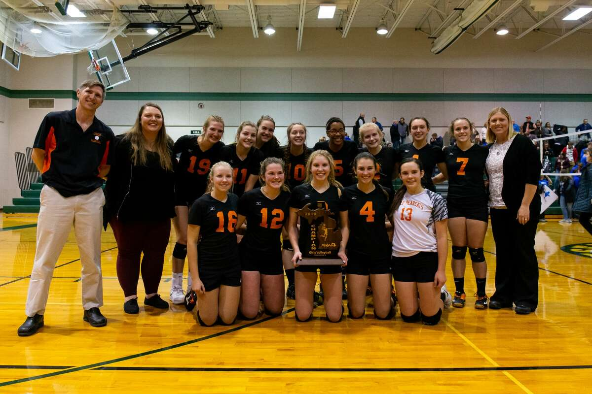 The Ubly Bearcats pose with their 2019 regional volleyball championship trophy.