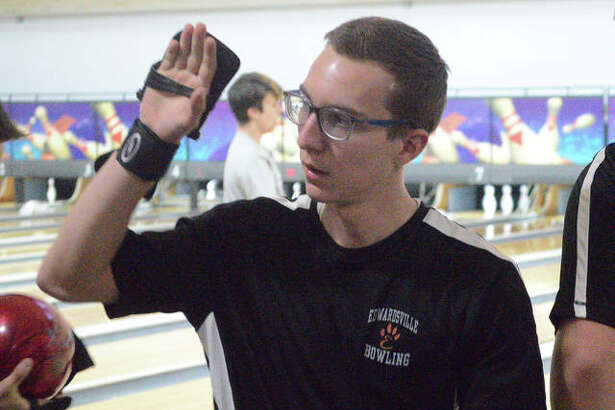 Edwardsville junior Jackson Budwell gives a high five to a teammate after one of his 10 consecutive strikes during his final game Thursday in the Southwestern Conference Tournament at Bel-Air Bowl in Belleville. Budwell finished with a career-high game of 288.