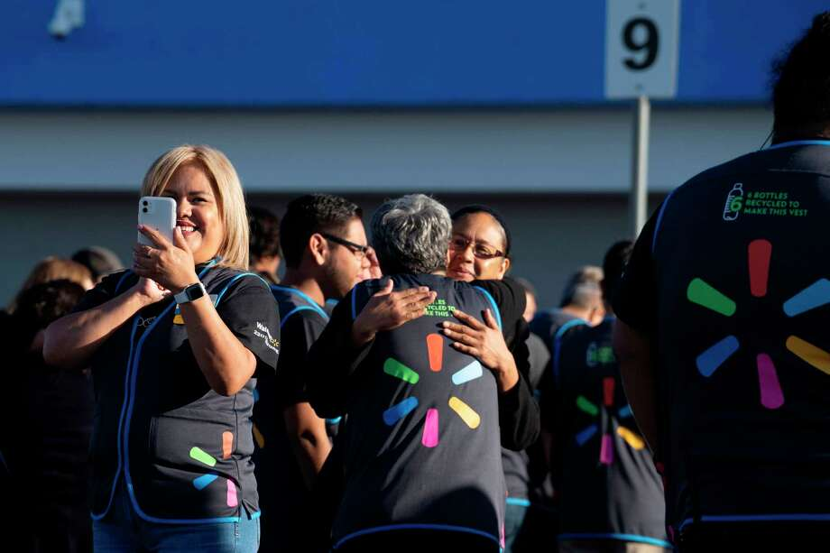 Employees gather for the reopening of the El Paso Walmart that was the scene of the mass shooting this summer that claimed the lives of 22 people. Photo: Paul Ratje / AFP / Getty Images / AFP or licensors