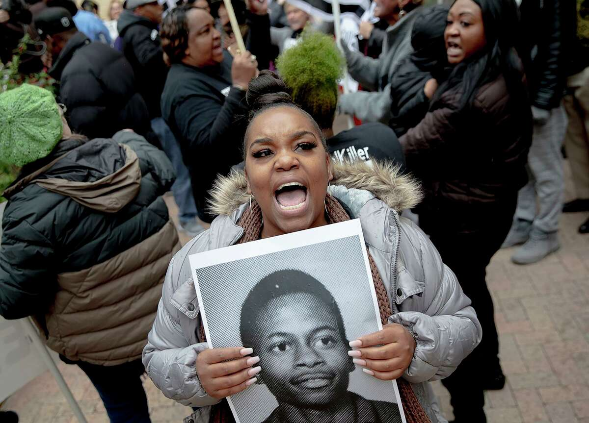 Brittani Smith chants during a protest against the execution of Rodney Reed on Wednesday, Nov. 13, 2019, in Bastrop, Texas. Protesters rallied in support of Reed's campaign to stop his scheduled Nov. 20 execution for the 1996 killing of a 19-year-old Stacy Stites. New evidence in the case has led a growing number of Texas legislators, religious leaders and celebrities to press Gov. Greg Abbott to intervene. (Nick Wagner/Austin American-Statesman via AP)
