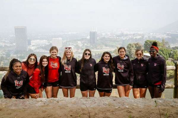 Lamar University soccer players pose for a picture during a stop on their celebrity bus tour through Hollywood Hills. Photo taken on Thursday Nov. 14, 2019 by Jon Washington, Lamar athletics.