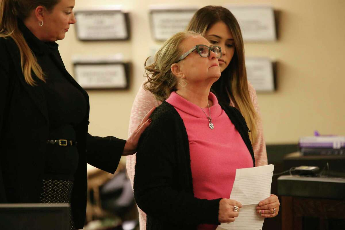 Kandy Perkins, mother of murder victim Randall Perkins, reacts while giving an impact statement in court after Leandre Hill, 29, was sentenced to 40 years in prison on Thursday. Hill was sentenced in the death of Perkins' son, Randall Perkins, 20, at a party in 2012. Perkins was an assistant lacrosse coach.
