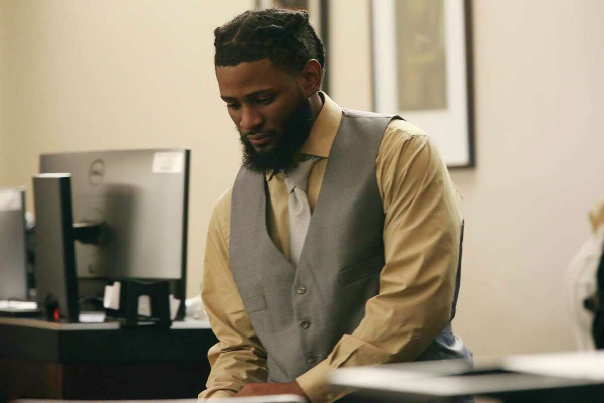Leandre Hill, 29, enters the 379th State District Court in San Antonio before being sentenced to 40 years in prison in the 2012 slaying of 20-year-old assistant lacrosse coach Randall Perkins.