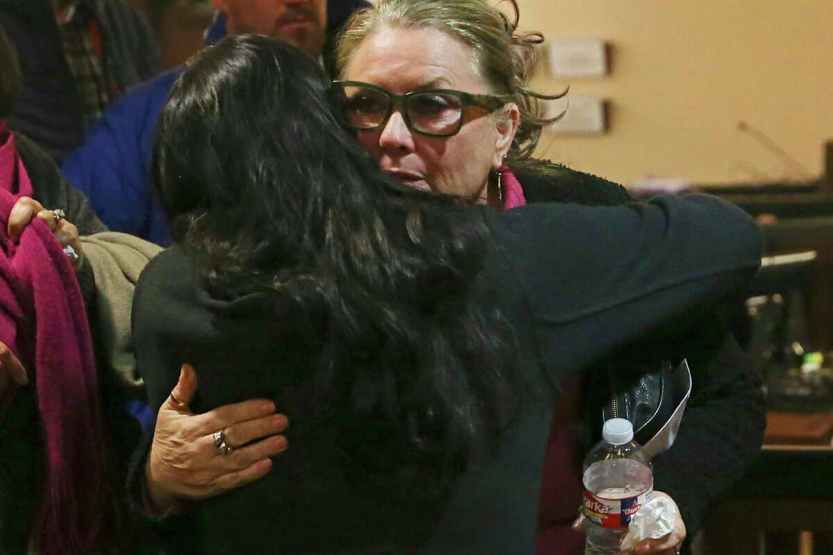 Kandy Perkins, mother of murder victim Randall Perkins, receives a hug after Leandre Hill, 29, was sentenced to 40 years in prison on Thursday. Hill was sentenced for Randall Perkins' death, which occurred at a party in 2012. Perkins, 20, was an assistant lacrosse coach.