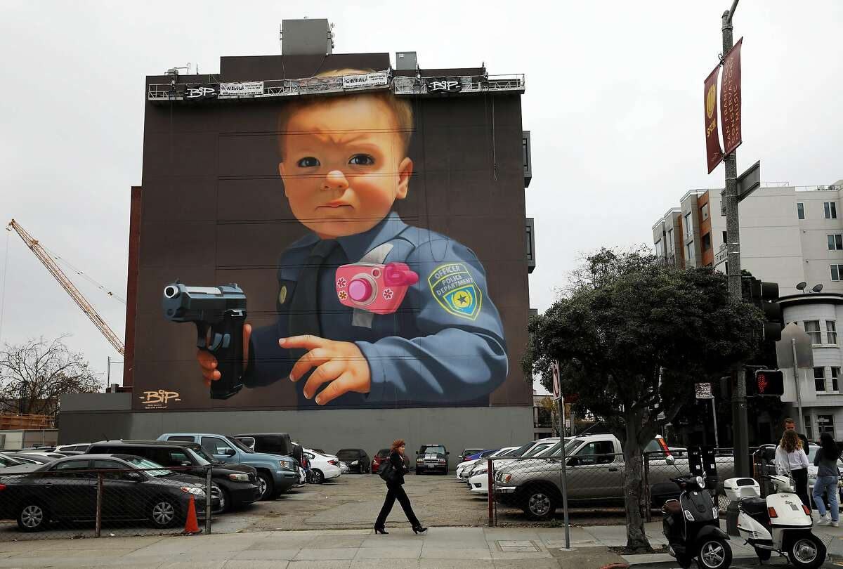 San Francisco muralist BiP's mural is located at 22 Franklin St., in San Francisco, Calif., on Thursday, November 14, 2019. He recently completed a mural with an image of a young boy, dressed in a police uniform, holding a gun. The controversial mural protests police brutality.