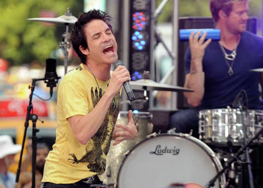 "Musician Patrick Monahan of Train performs on CBS' ""The Early Show"" at CBS Early Show Studio Plaza on August 9, 2010 in New York City. Train will be the featured band at the town of Trumbull's annual summer concert at Indian Ledge Park on Friday Sept. 10, 2010. Photo: Bryan Bedder, Getty Images / 2010 Getty Images"