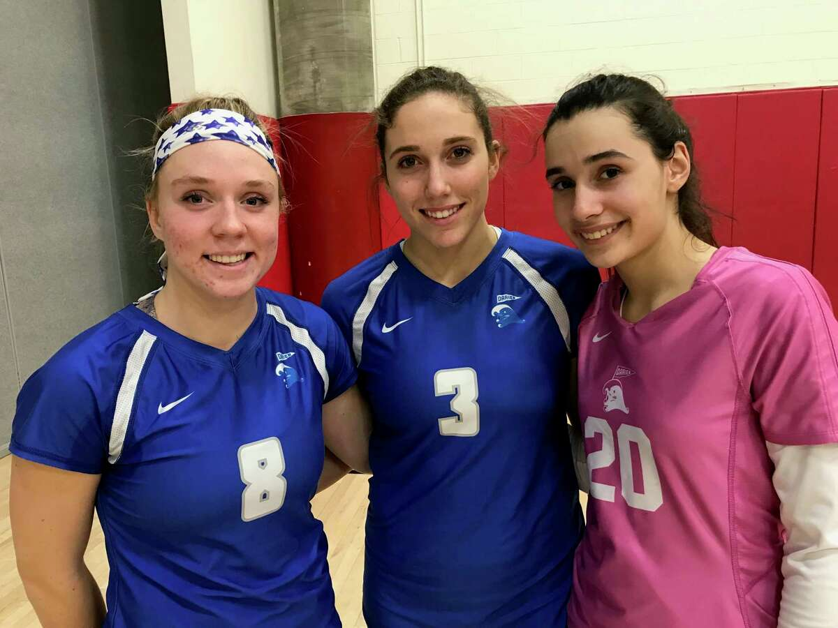 From left to right, Elaina Cummiskey, Lindsey Fay and Sophia Talwakar finished their senior seasons as captains of the Darien volleyball team on Thursday, November 14, 2019, in Greenwich.