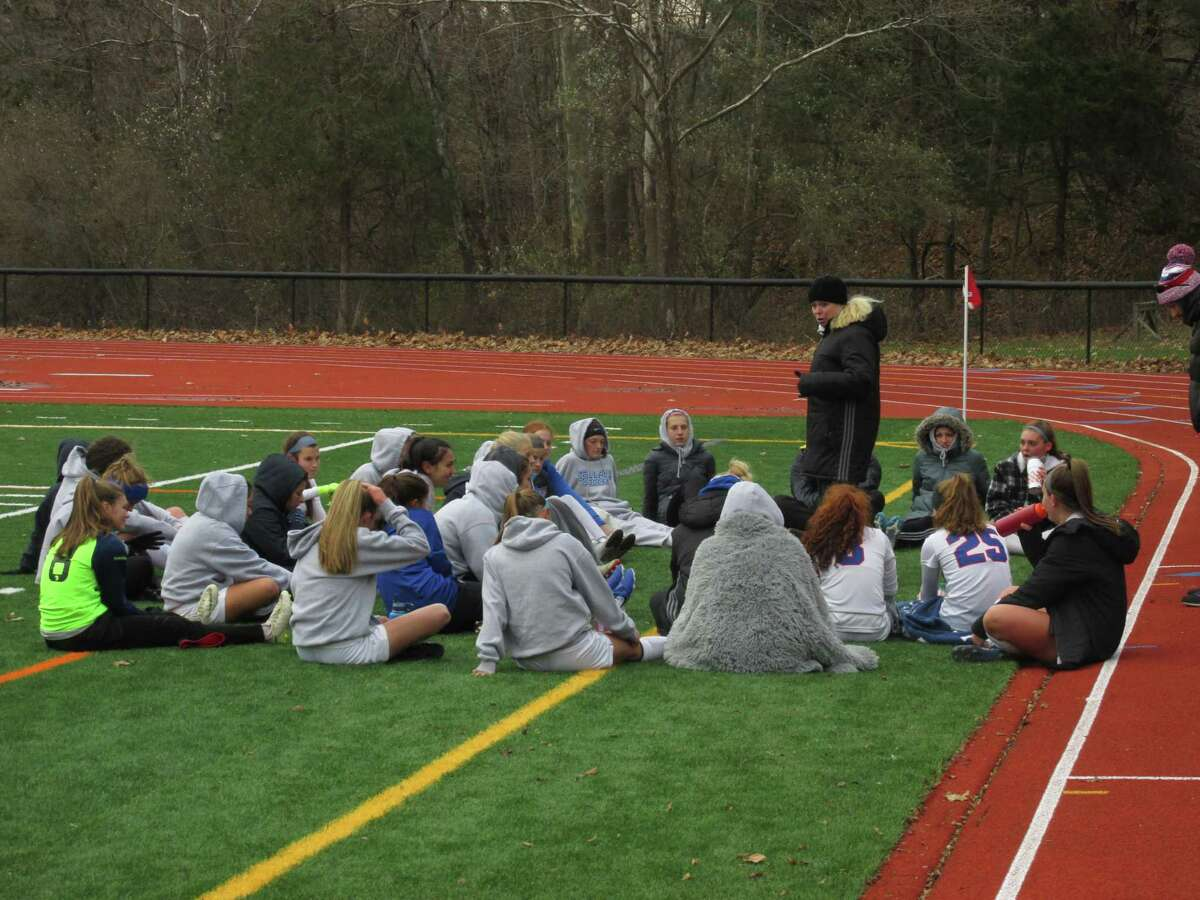 Tolland coach Erin Reed stoked her team at the half for their Class M second-round win at Nonnewaug High School on Thursday, Nov. 14, 2019.