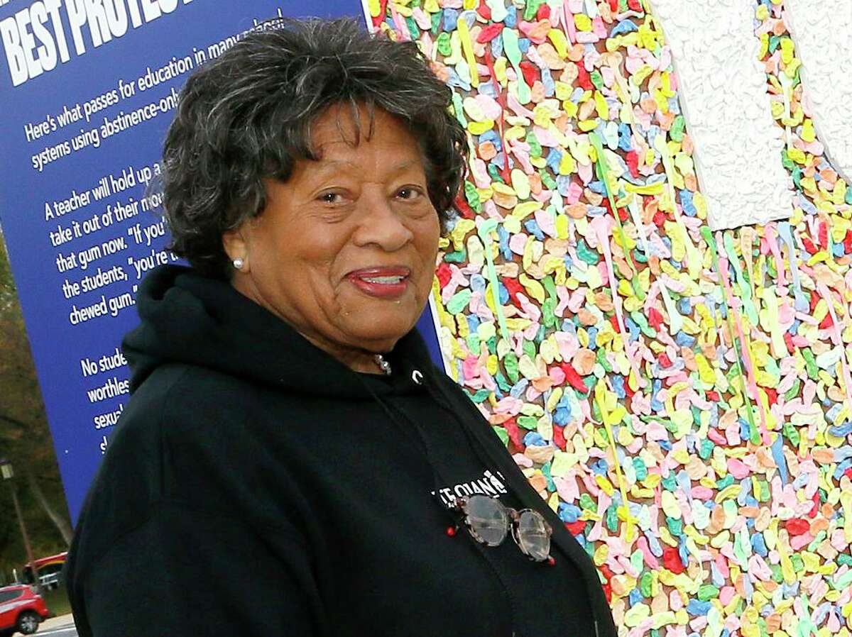 Former U.S. Surgeon General Dr. Joycelyn Elders stands beside a wall of chewed gum installed by Trojan and Advocates for Youth drawing attention to shame-based abstinence-only programs in schools as they advocate for quality sex education on Wednesday, Oct. 30, 2019 in Washington. Elders spoke Nov. 14 at the University of Houston.