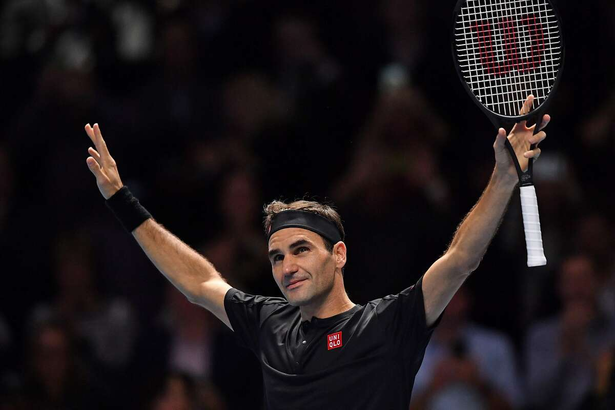 Switzerland's Roger Federer celebrates his straight sets win over Serbia's Novak Djokovic in their men's singles round-robin match on day five of the ATP World Tour Finals tennis tournament at the O2 Arena in London on November 14, 2019. - Roger Federer beat Novak Djokovic 6-4, 6-3 to reach the last four at the ATP Finals on Thursday, a result that confirms Rafael Nadal will finish the year as world number one. (Photo by Ben STANSALL / AFP) (Photo by BEN STANSALL/AFP via Getty Images)