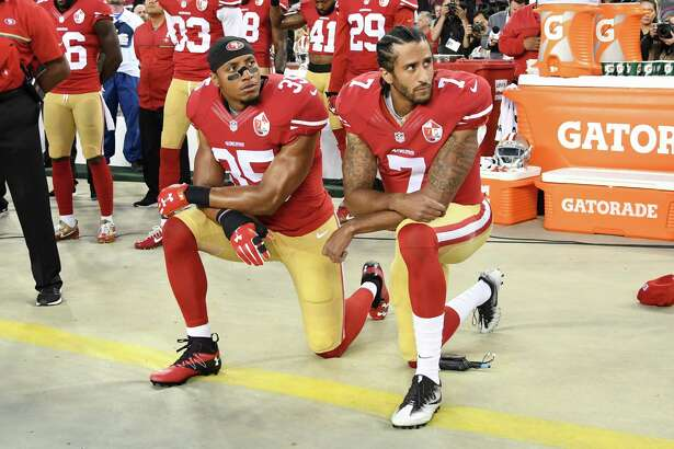 SANTA CLARA, CA - SEPTEMBER 12: Colin Kaepernick #7 and Eric Reid #35 of the San Francisco 49ers kneel in protest during the national anthem prior to playing the Los Angeles Rams in their NFL game at Levi's Stadium on September 12, 2016 in Santa Clara, California. (Photo by Thearon W. Henderson/Getty Images) ORG XMIT: 659019765