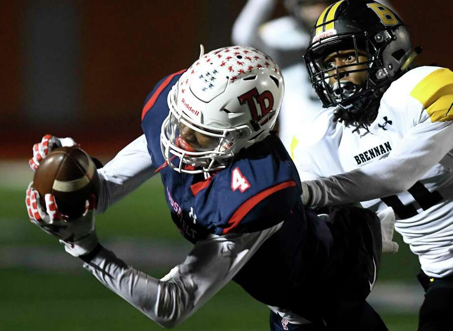 Roosevelt receiver Daqwon Kindred hauls in a pass reception as Brennan's Ticoroyo Battles defends during Class 6A Division II first-round playoff action at Heroes Stadium on Thursday, Nov. 14, 2019. Photo: Billy Calzada / Staff Photographer / San Antonio Express-News