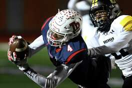 Roosevelt receiver Daqwon Kindred hauls in a pass reception as Brennan's Ticoroyo Battles defends during Class 6A Division II first-round playoff action at Heroes Stadium on Thursday, Nov. 14, 2019.